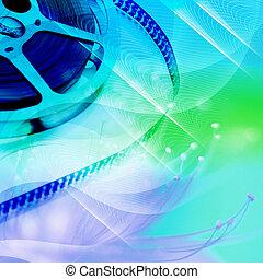 Film Reels - Reel of movie film unwinding, blue filter