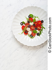 Caprese salad with mozzarella and tomatoes