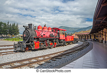 Old locomotive train on a railroad track, parked at a train...