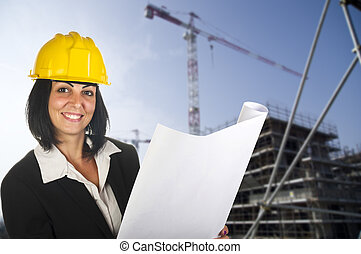 Happy young female architect working at the work