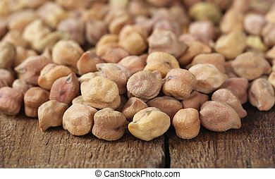 Raw Chickpea on wooden surfaace