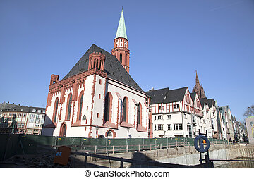 famous old Nikolai Church in Frankfurt at the central roemer...