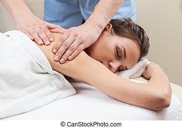 Lady having back massage in a spa
