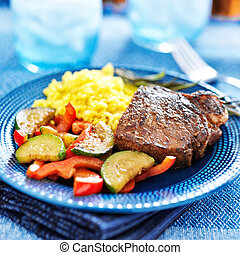 steak with vegetables and rice dinner