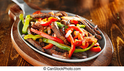 mexican beef fajitas with bell peppers panoramic shot