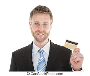 Confident Businessman Holding Credit Card - Portrait of...