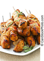 Chicken skewers - Pile of barbecued chicken kebab appetizers...