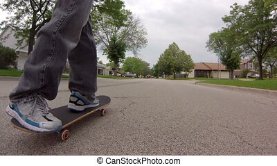 Following Skateboard on Street - Low angle tracking shot,...