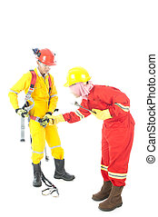Training - A woman teaching how to wear safety body harness...