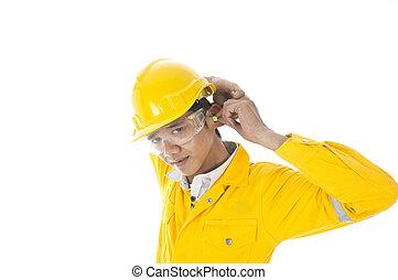 Wear ear protection - A man demonstrate how to wear ear plug...