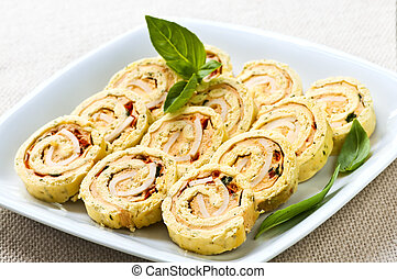 Mini sandwich spiral roll appetizers - Plate of many mini...