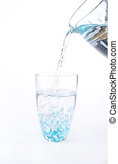 Stock photo of water being poured into a glass - Water is...