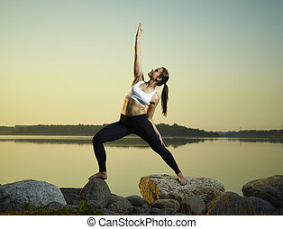 Yoga in the morning - The beautiful young woman exercise...