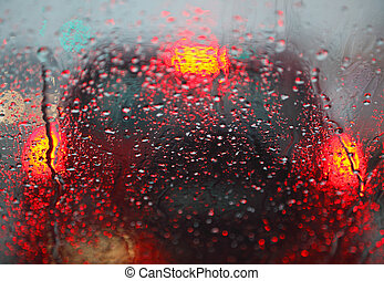 Traffic in the rain 01 - Lights of cars at an intersection...