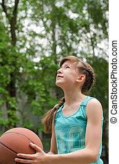 Young boy playing basketball - Young boy having fun playing...