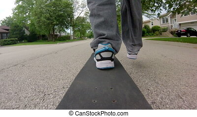 Skateboard Ride in the Street - Wide angle shot from the...