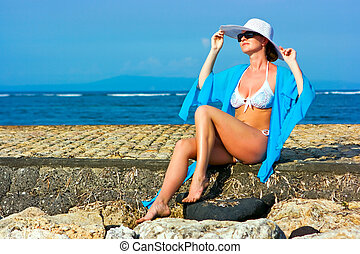 Lady in blue shawl on the beach - Brunette lady with white...