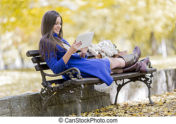 Woman with tablet in the park