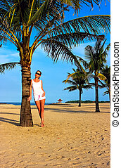 Brunette girl standing on the lonely sand beach - Beautiful...