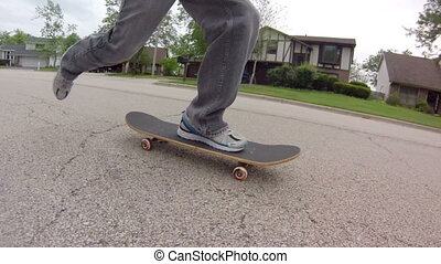 Skateboarding on Street - Low angle tracking shot, following...