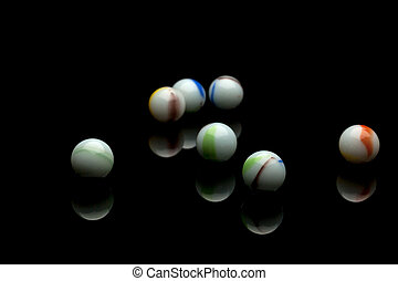 Marbles - photo of color marbles on black with reflection