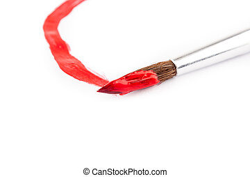 paint brush with red paint on white paper