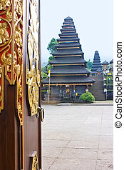 Doorway to the temple square - Gold door in the buddhist...