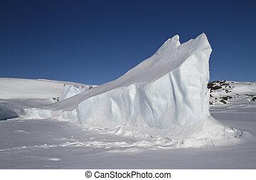 elongated iceberg frozen in Antarctic islands winter day