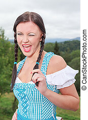Young girl in dirndl with gaiety - Young Bavarian girl in a...