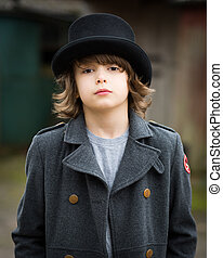 Boy in Long Coat and Top Hat - Portrait of a boy with long...