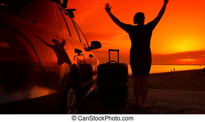 Summer beach vacation destination, woman with suitcase near...