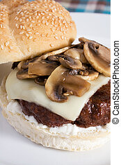 Mushroom Swiss Burger - A delicious burger topped with swiss...