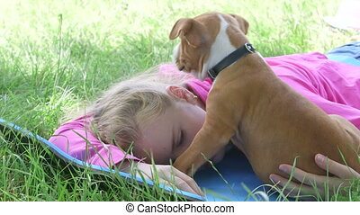 Sleepy puppy dog - Little girl with sleepy puppy dog lying...