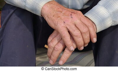 Senior man with cigarette gesticulating hand close-up -...