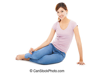 happy and beautiful young student sitting on the floor