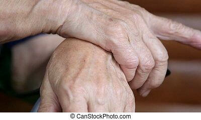 Gesticulating hands of senior woman during a conversation...