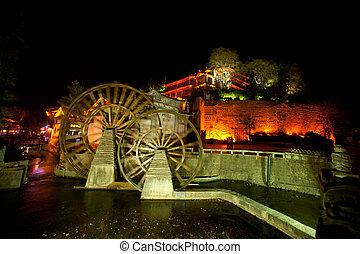 Water wheel ,landmark of Lijiang Dayan old town at night.