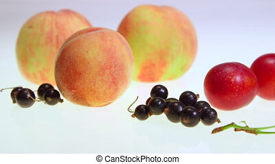 Dolly: Variety of fresh fruits and berries background...
