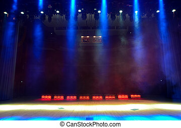 Illuminated empty concert stage with smoke - View from the...