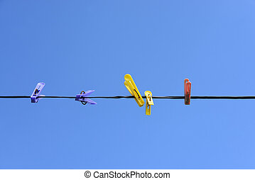 Clothespins - Colorful plastic clothespins on a background...