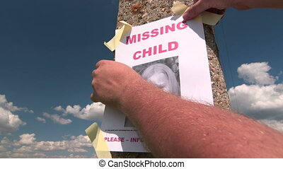 Posting photograph of missing child on pole