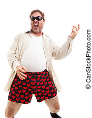 Air Guitar in Underwear - Middle aged man playing air guitar...