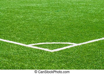 White corner marker on green sports turf - White corner line...