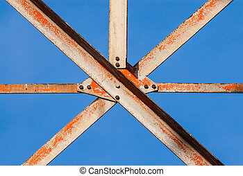 Metal girders crossing with screws - Worn metal girders...