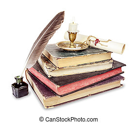 Old books, candle in candlestick, feather in inkpot and...