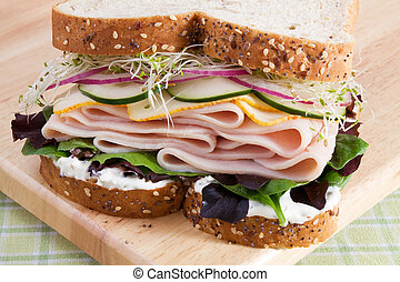 Healthy Turkey Sandwich - Multi-grain bread filled with...