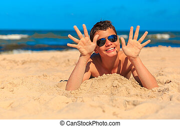 Happy young boy on the sea beach - Happy laughing boy of...