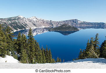 Crater Lake National Park, Oregon - Clear blue water of...