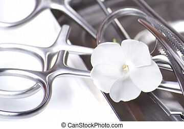 surgical tools with flower - one concept of association of...