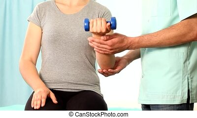 Lifting weights on physiotherapy visit movie
